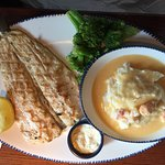 Grilled rainbow trout, Langostino lobster mashed potatoes, and broccoli