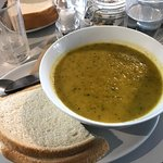 Carrot and courgette soup with white bread and frozen butter