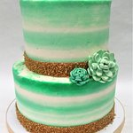 2-tier Green and White Cake with Gold Accents and Succulents