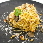 House made spagetti,sundried tomato,truffle, granna padano