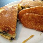 Blueberry pancakes stuffed with egg, sausage, cheese & hashbrowns