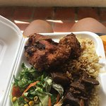 Delicious meal (fried chicken, lamb stew, rice & split pea) sold by local food truck/van near ho