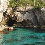 One of the many caves we snorkeled around