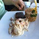 Seafood mofongo: mahi mahi, shrimp, scallops in the ajillo sauce.