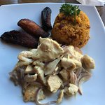 Pollo Ajillo, with fried plantains and 'mexican' style rice and beans.