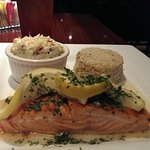 Salmon with Rice Pilaf and Coleslaw.