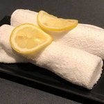 Hand Towels with Slices of Lemon on Them