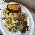 Scrambled eggs with corn bread and potatoes