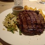Rib-eye steak and chips.