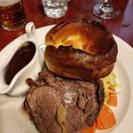 Beef Sunday lunch, there's spuds, carrots and cabbage hiding under that great Yorkshire pud !