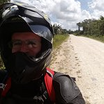 A huge smile while riding on a typical secondary rd in Belize.
