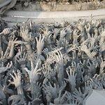 Hands reaching from Hell toward Heaven