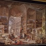 """In the dining room hangs this print of Giovani Panini's intricate """"Ancient Rome,"""" painted in 175"""