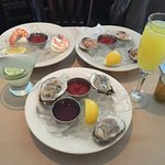 raw samples, clams, oysters, shrimp. Mimosa and margarita.