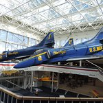 Four Blue Angel planes flying in formation and how close they fly to each other.