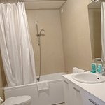 bathroom in master bedroom with washing machine