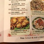 """Menu showing the """"Braised abalones over beef chow fun"""""""