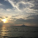 Sunset with silhouette of the Mt Agong of Bali viewed from the beach front