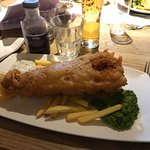 A well battered fish with some rather puny chips