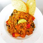 Homemade jambalaya with fresh lime & garlic bread, available as vegan mushroom or chicken & chor