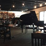 Elegant Grand piano dining space at Red Fish