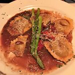 Short rib stuffed ravioli, asparagus spears on top