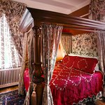 Ruby Room with queen bed imported from England and very large jetted tub with hand held shower.