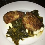 Pan-fried Pork Shoulder with grits and greens