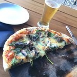 Awesome pizzas and wine selection. Tiger on tap, just saying. Great relaxing Lounge atmosphere.