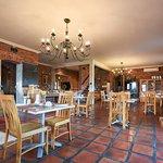 Enjoy breakfast in our rustic restaurant area.