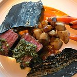 Lamb roast with vegetable ash chips & carrot humus