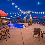 Pool and patio area of Cameo Heights come alive in the evening with overhead lights.