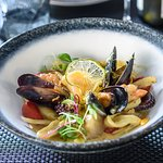 Seafood pasta with dried free-range egg yolk, octopus, tiger prawns, sea scallop and squid