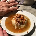 matzoh ball covered with chicken bits (with fancy fingernails)
