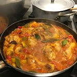 The chicken simmering in its incredible sauce