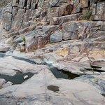 water beneath petroglyph wall