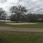 Behind our campsite was a volleyball court, pavilion, swim area & playground!
