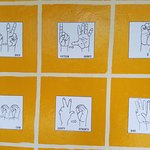 Nicaragua Sign Language (NSL) examples on the wall