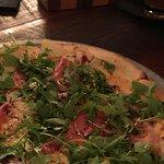 Prosciutto pizza with pear and gorgonzola