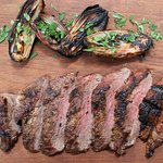 Pluma Ibérica - Josper seared & served with coal roasted shallots