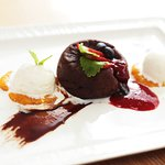 Сhocolate cake with ice-cream, strawberry-basil sauce and apricot puree