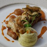 Slow cooked belly pork with mushroom and crème fraiche gratin, pork crackling, toffee apple sauc