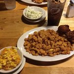 Fried Popcorn Shrimp with side, breaded corn and coleslaw.
