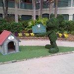 Shadow dog house with Mickey topiery.