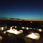 Panoramic Rooftop Sunset Views are unmatched! Perfect music to match the design and the food.