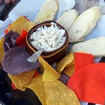 crab dip with chips and thinly sliced bread