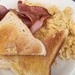 Scrambled eggs on toast with bacon