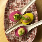 Our colorfull pickled deviled eggs with creamy yolk filing.  A bar favorite.