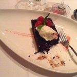 Delicious chocolate cake with real whipped cream and raspberries!