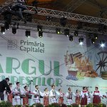 Folk singers and dancers performing on main stage